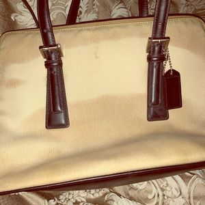 Coarch tote or crossbody.  H2O damage on canvas